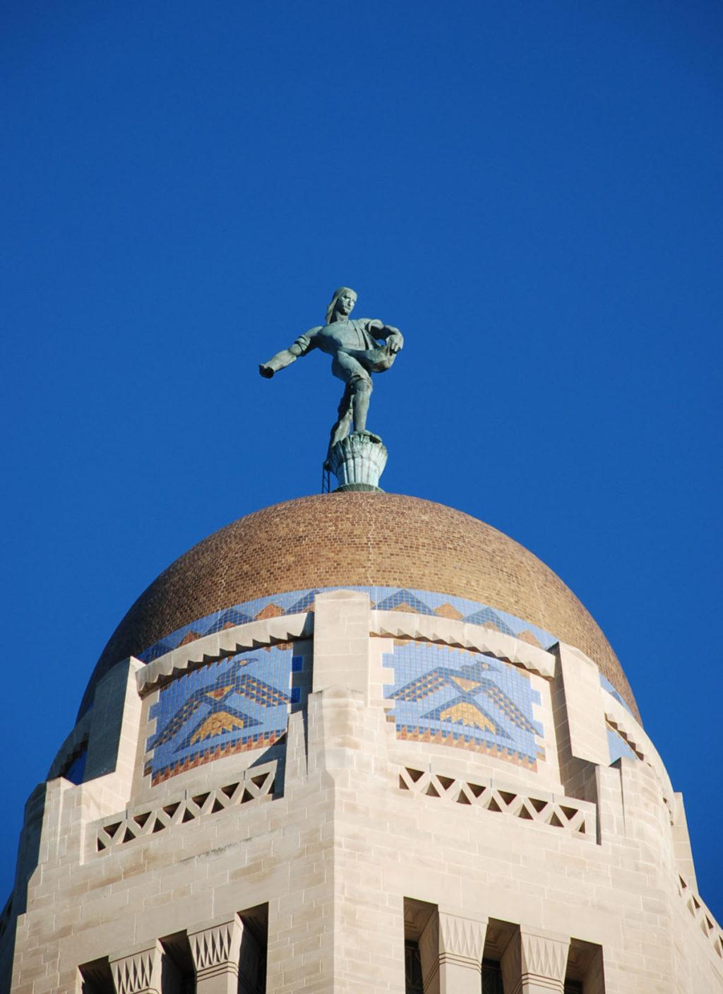 Thunderbird beneath gold dome